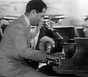 Gershwin playing I Got Rhythm at the opening of the Manhattan Theatre, New York, August, 1931